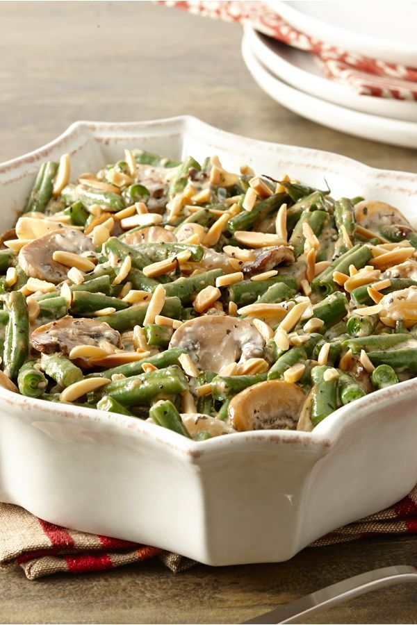 Make the classic green bean casserole from scratch with caramelized mushrooms and onions. Guests will love this gluten-free holiday side dish.