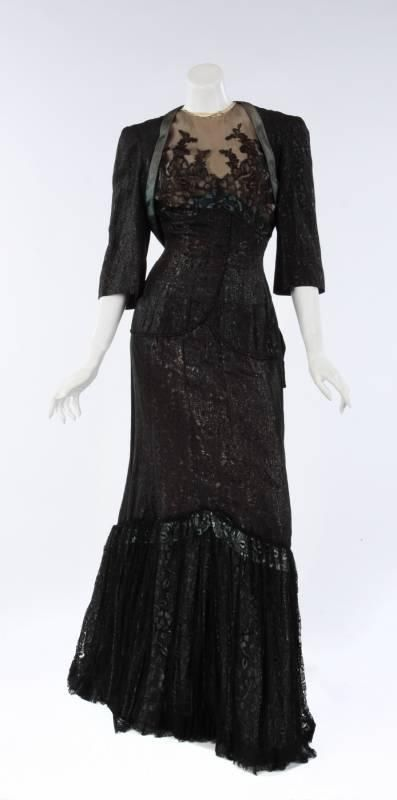 "A black floral brocade period gown worn by Alexis Smith in ""San Antonio"" (1945).  Costumes by Milo Anderson."