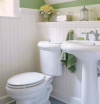 Benjamin Moore's Sherwood Green covers the walls above the beadboard wainscoting in this pretty half-bath.  Photo: Andrew Bordwin   thisoldhouse.com Guest bath?