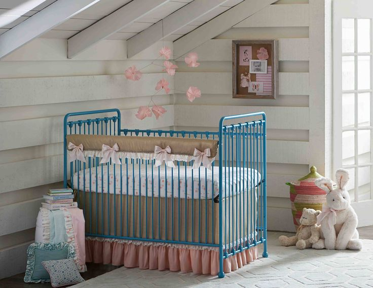 Pink and Gold crib bedding on an aqua blue crib from BabysDreamFurniture