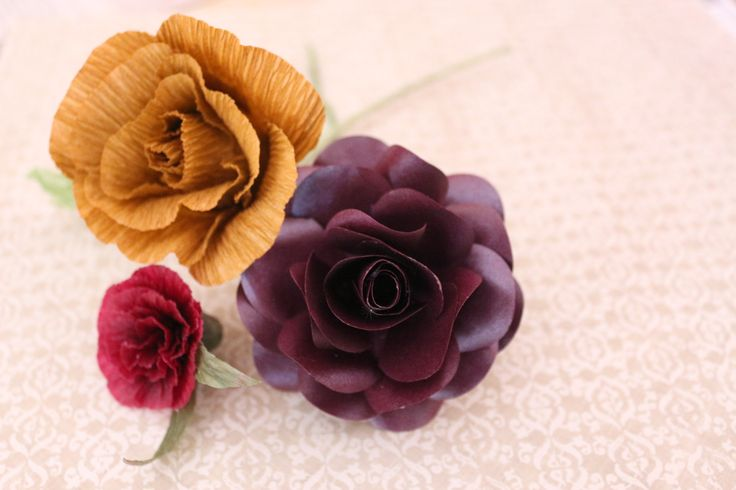 We love all sorts of flowers! Check out this combination of crepe paper flowers and card stock flowers!