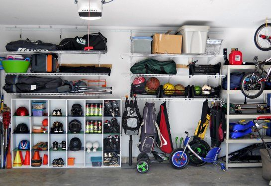 25 best ideas about sports equipment storage on pinterest for Over car garage storage