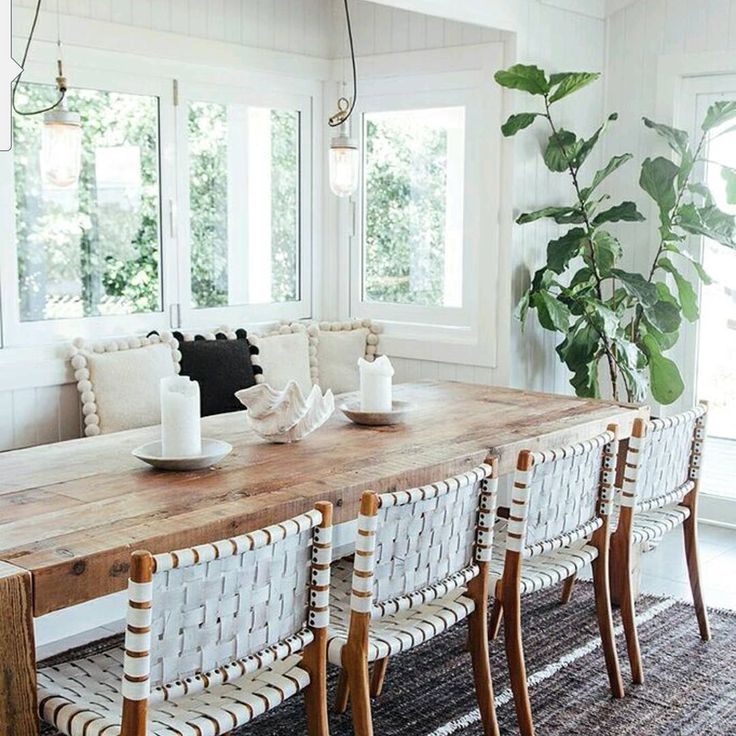 hanging vintage style pendants | large fiddle leaf fig | wooden slab table | woven leather dining chairs