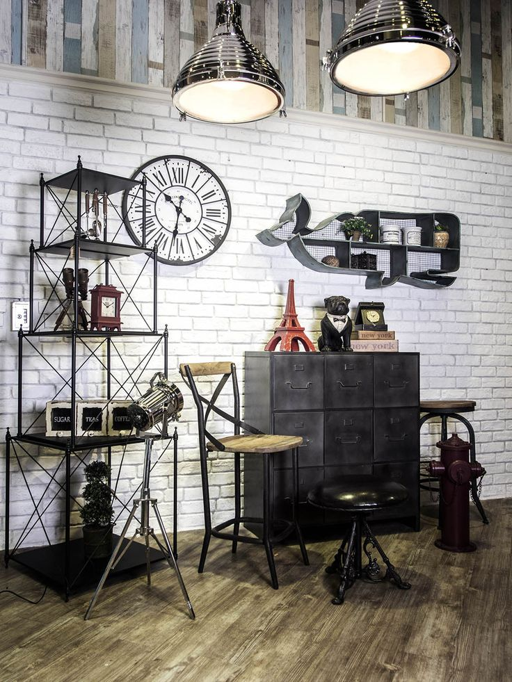 industry-home;  Such a cool industrial look behind shelving & would work at home as well!