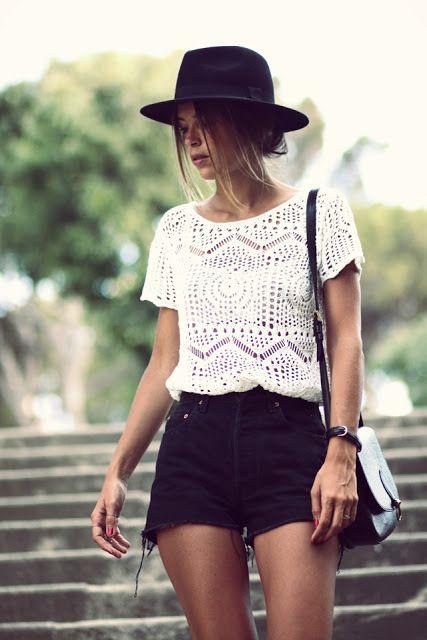 Simple summer fashion: crochet top, black shorts, hat.