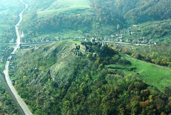 The Şoimoş Fortress is situated in the village of Şoimoş, now part of the city of Lipova, Arad County, Western Romania. It was raised on the right bank of Mureş River, on Cioaca Tăutului Hill. 13th Century.