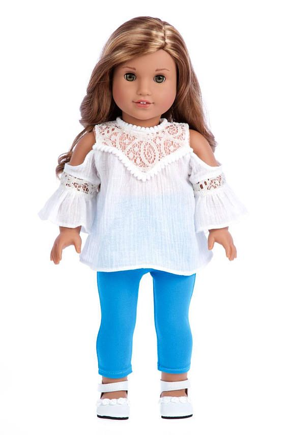 Trendy Girl 4 piece doll outfit includes white cotton blouse, turquoise leggings and white shoes. * DOLL(S) NOT INCLUDED * U.S. CPSIA CHILDRENS PRODUCTS SAFETY CERTIFIED * Our 18 inch doll clothes are designed to fit American Girl Doll, Our Generation Doll, My Life Doll, Journey
