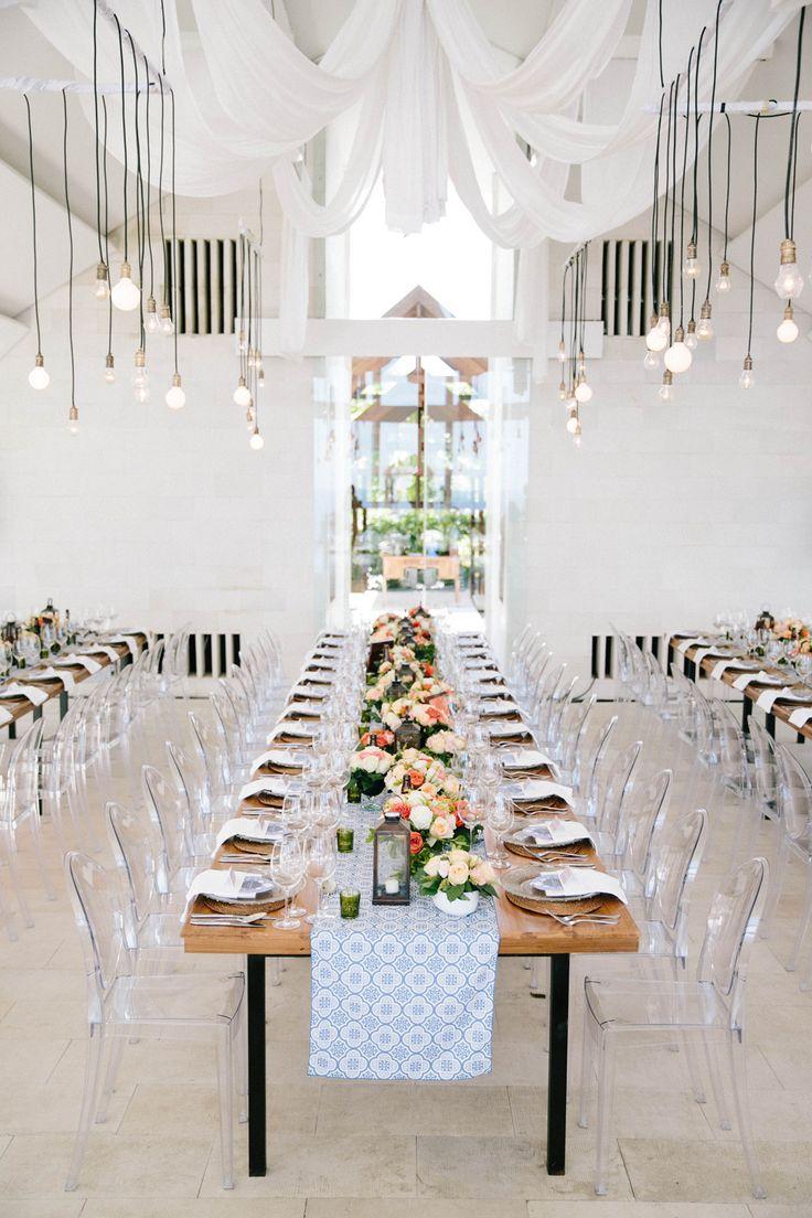 Love the long tables, lights + chairs. Photography: Angga Permana