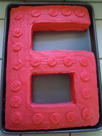 Our friend, David, was turning 6 and wanted a Lego Cake. We got to work.       Start off with two sheet cakes. I used jelly roll pans a...