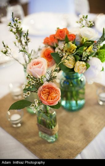 Juliet garden roses, coral ranunculus, yellow parrot tulips, spray roses, veronica, viburnum, waxflower