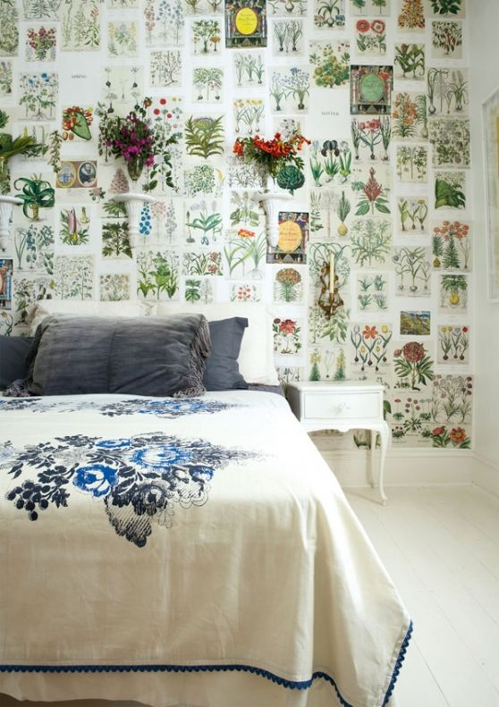 Bedroom with botanical prints and vases/flower pots on the wall