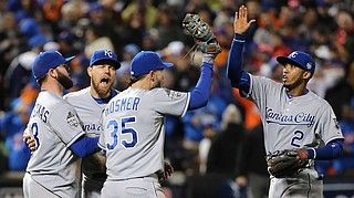 Royals Lead 3-1 Over Mets In World Series - Mike Moustakas #8, Ben Zobrist #18, Eric Hosmer #35 and Alcides Escobar #2 of the Kansas City Royals celebrate after defeating the New York Mets by a score of 5-3 to win Game Four of the 2015 World Series at Citi Field on Saturday night.