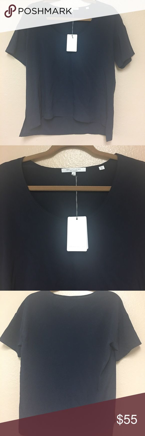Bella Lucc    Silk Basic Navy Short Sleeve Top, XS Relaxed silk blouses in a size XS. New with tags! Bundle and save 20% off 2+ items. 🚫No trade and 🚫No transactions outside Poshmark please. Thank you! Bella Luxx Tops Tees - Short Sleeve
