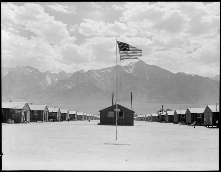 Manzanar Relocation Center, Manzanar, California. Street scene of barrack homes at this War Relocation Authority Center. The windstorm has subsided and the dust has settled.