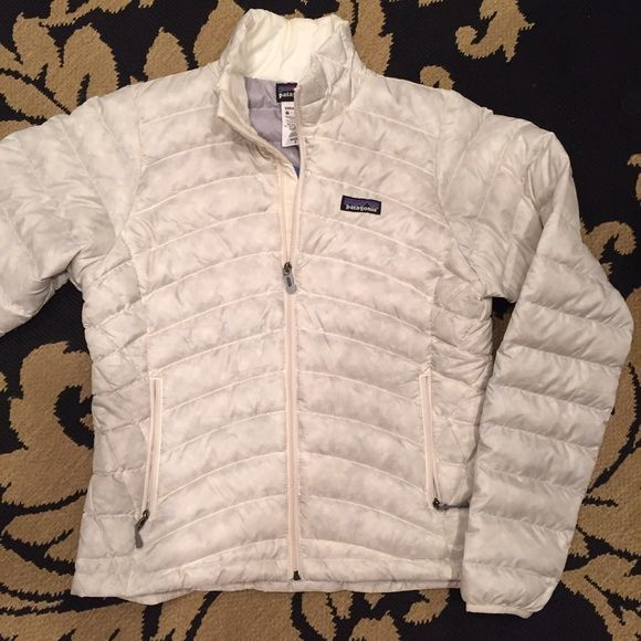 Patagonia Down Sweater Jacket Patagonia Down Sweater Jacket. Ivory- size small. New With tags with a tiny flaw on back of jacket. Looks like down feather stuck inside the  outer fabric.  Please see photo. It's really small and blends in so well I didn't notice it til I took pictures for this post. Jacket is kind of a transparent ivory ... You can see the down feathers if you look real close. Super comfy super lightweight. Patagonia Jackets & Coats Puffers