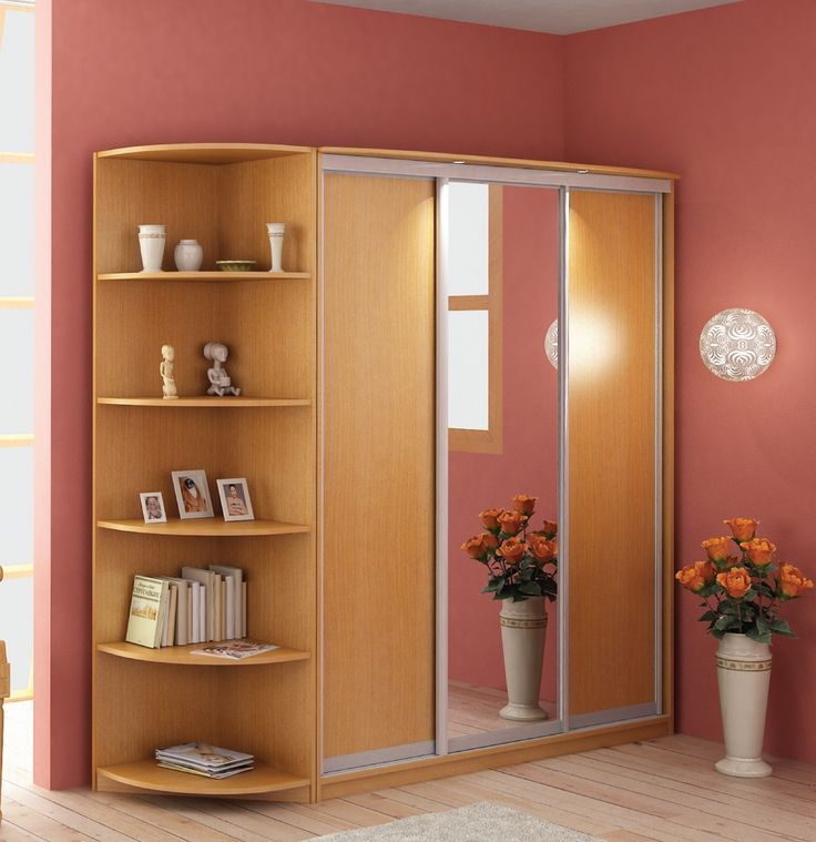 http://taizh.com/wp-content/uploads/2014/11/Fascinating-wooden-corner-wardrobe-plus-mirror-the-middle-also-book-shelves-beside-set-on-hardwood-flooring-ad-pink-painting-wall-decor-as-well-beautiful-wall-lamp.jpg