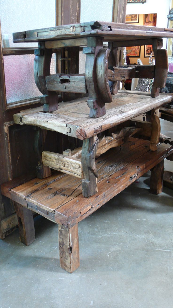 We love our antique Mexican door tables made with oxen - 11 Best Mexican Furniture Repurposed From Antique Mexican Doors