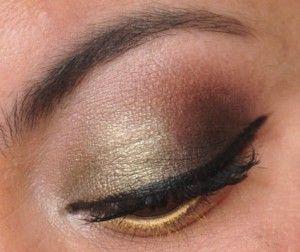 Smoky green eyeshadow with MAC Embark, MAC Greensmoke, MAC White Frost, and  NYX Glitzy Gold Slide On Liner.