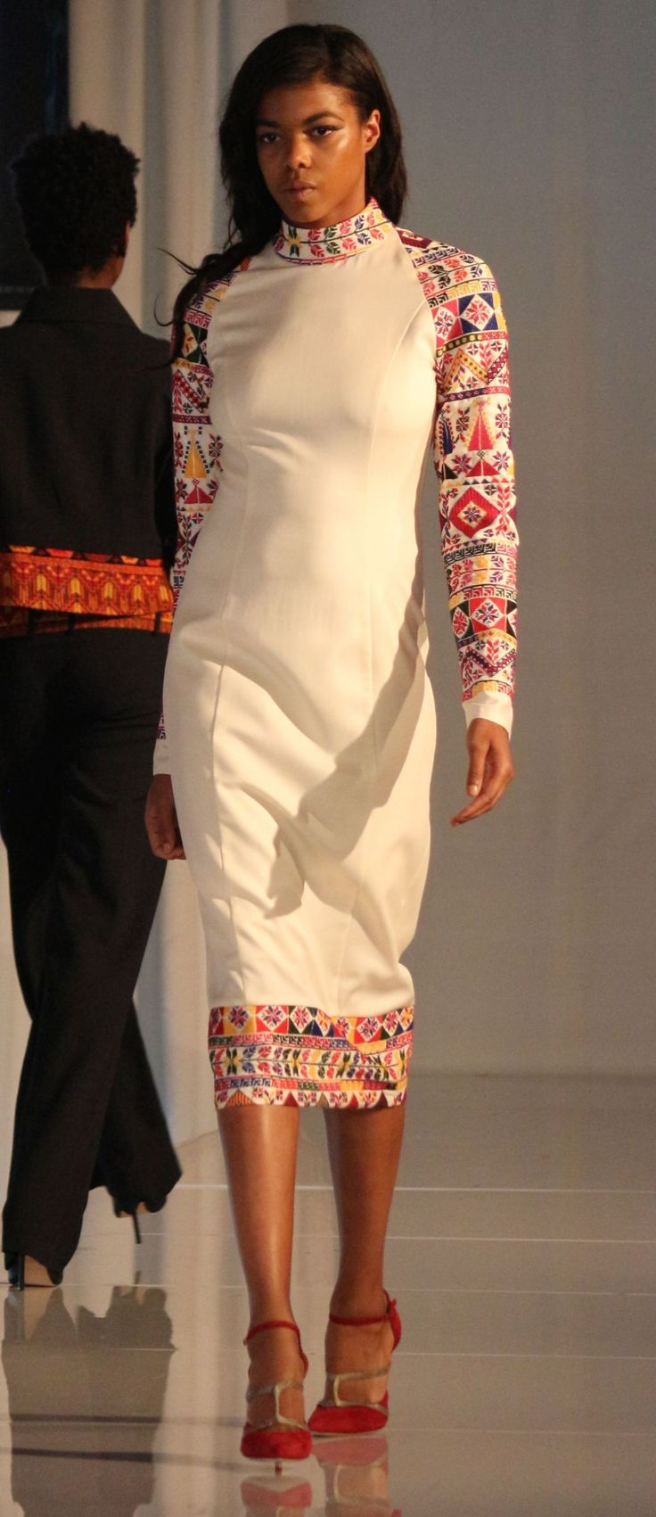 United nations fashion show -- Palestinian embroidery on a sheath dress