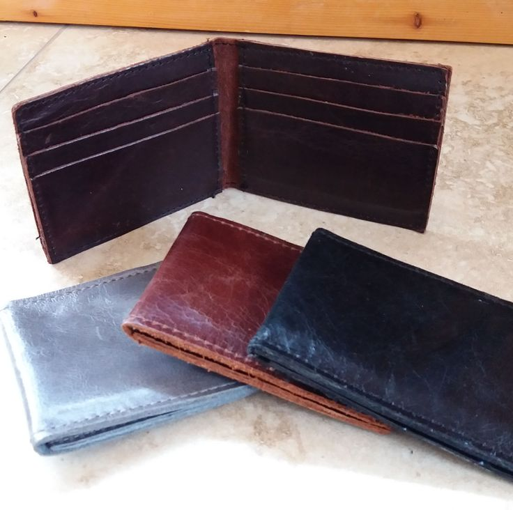 100% handmade leather card wallets.   Perfect for extra cards.  These can be personalized for a unique gift. #mensfashion #mensgift #groomsmen #weddingfavour #uniquegift #leatherfashion
