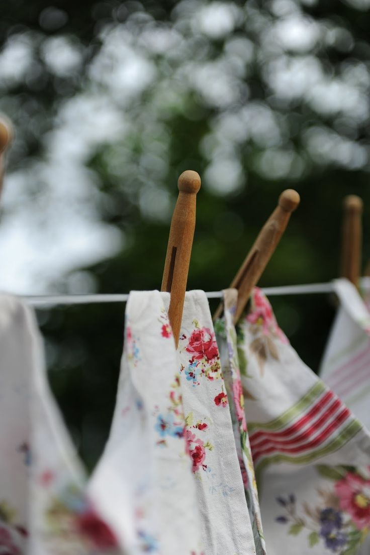 vintage pins hold sweet Spring linens dancing on gentle breezes on the clothesline