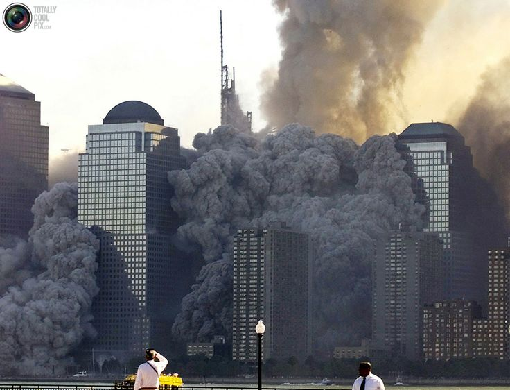The north tower of the the World Trade Center collapses in New York in this September 11, 2001 file photo.