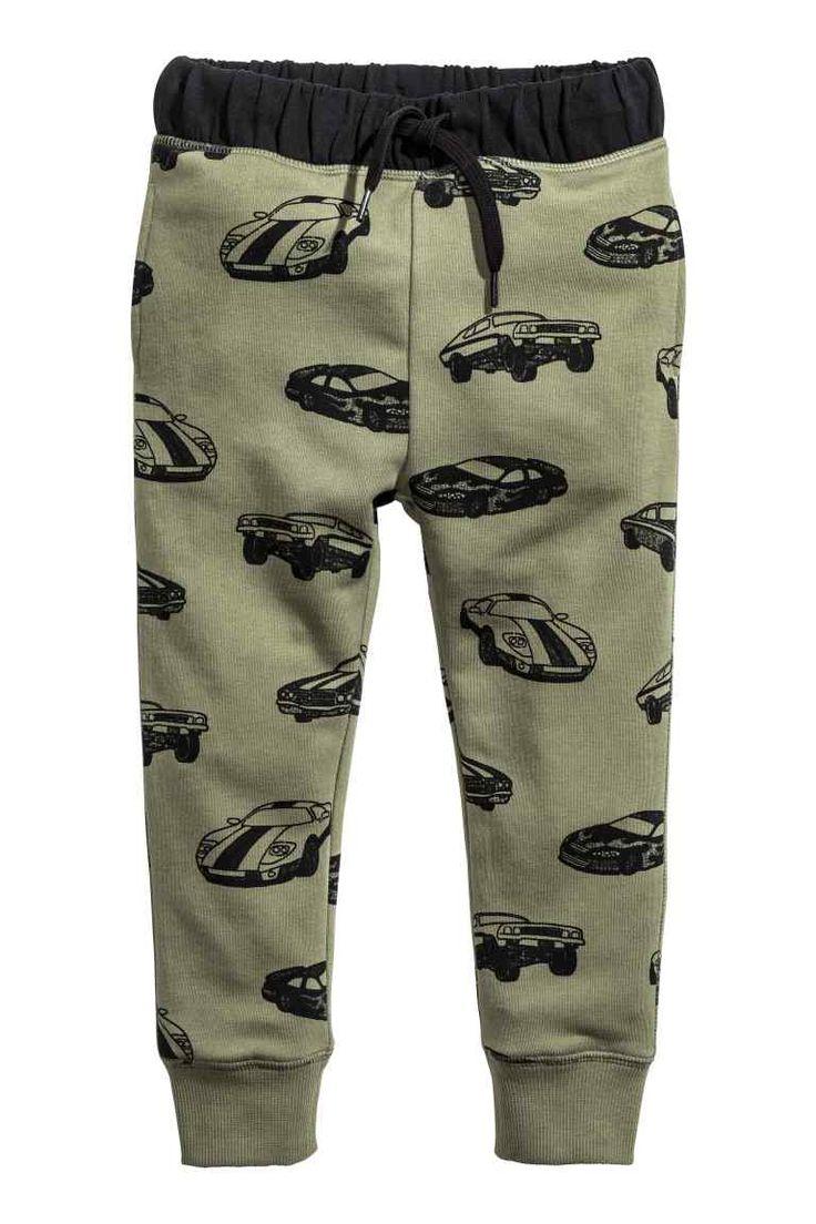 Pantalon jogger: Pantalon jogger en molleton avec impression. Modèle avec élastique et lien de serrage à la taille. Poches latérales. Bord-côte en bas de jambe.