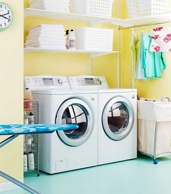 Yellow Laundry room with bright, cheerful blues. Nice match next to our turquoise bathroom.