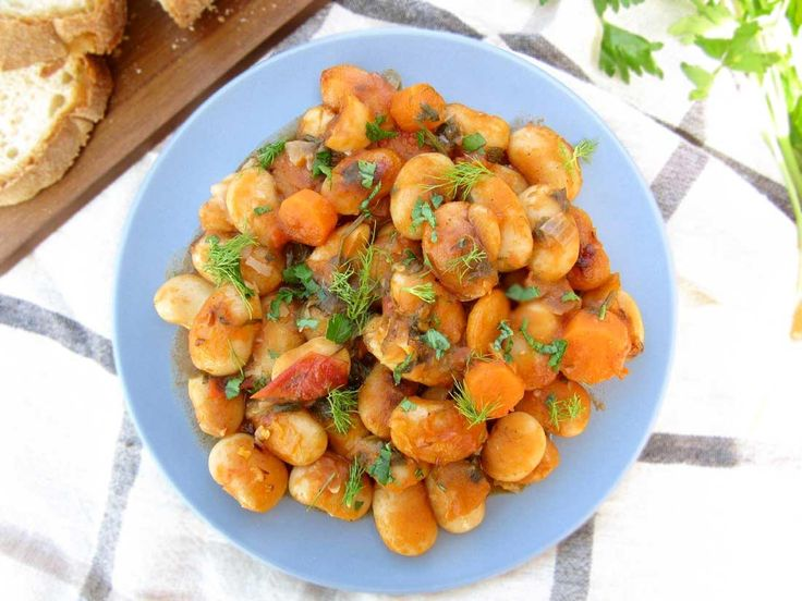 These delicious beans with their creamy texture and buttery flavor are cooked in a tangy tomato sauce packed with fresh herbs. It's a very nutritious bean recipe that can be served as a starter, side dish or main. #butterbeans, #limabeans,#Greekbeans,#Gigantes