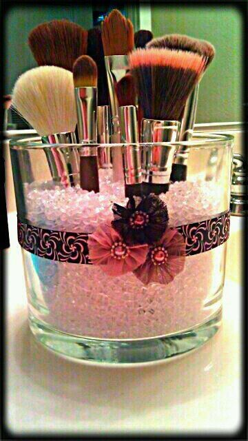 Re-use an old candle jar:  Add vase-filler pebbles to stand your make-up brushes ... nifty!