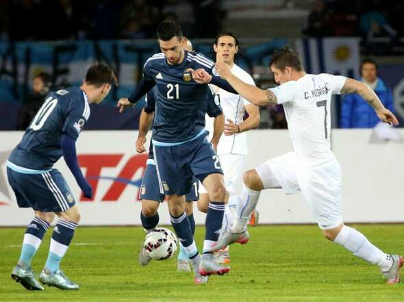 Argentina 1 Uruguay 0 in 2015 in La Serena. Javier Pastore and Christian Gonzalez battle for the ball in Group B at Copa America.