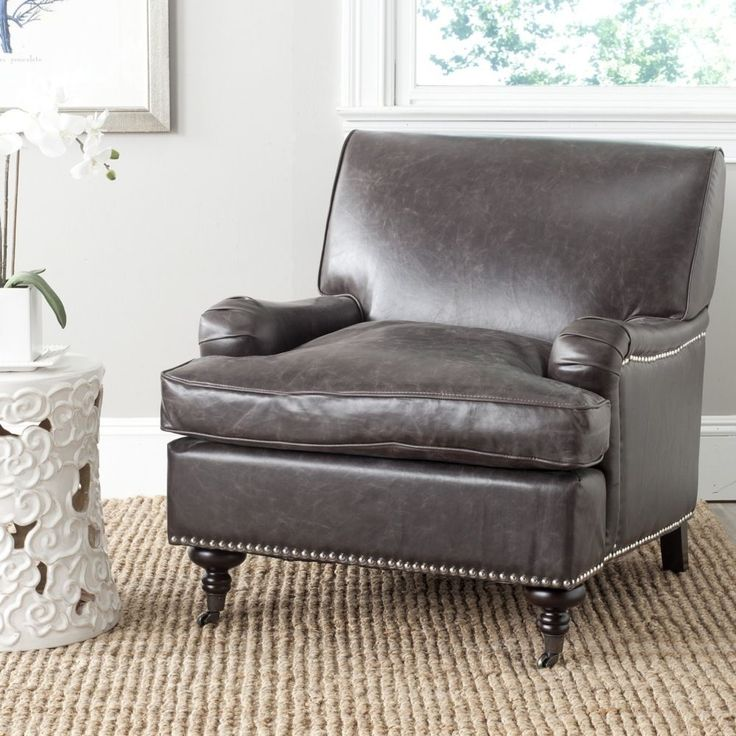 Sit back and relax in the sophisticated yet inviting Chloe club chair.