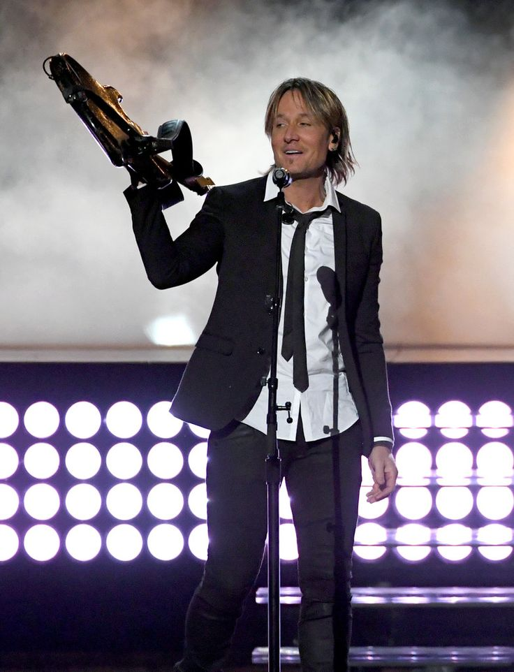 Keith Urban Photos Photos - Recording artist Keith Urban performs during the 52nd Academy of Country Music Awards at T-Mobile Arena on April 2, 2017 in Las Vegas, Nevada. - 52nd Academy of Country Music Awards - Show