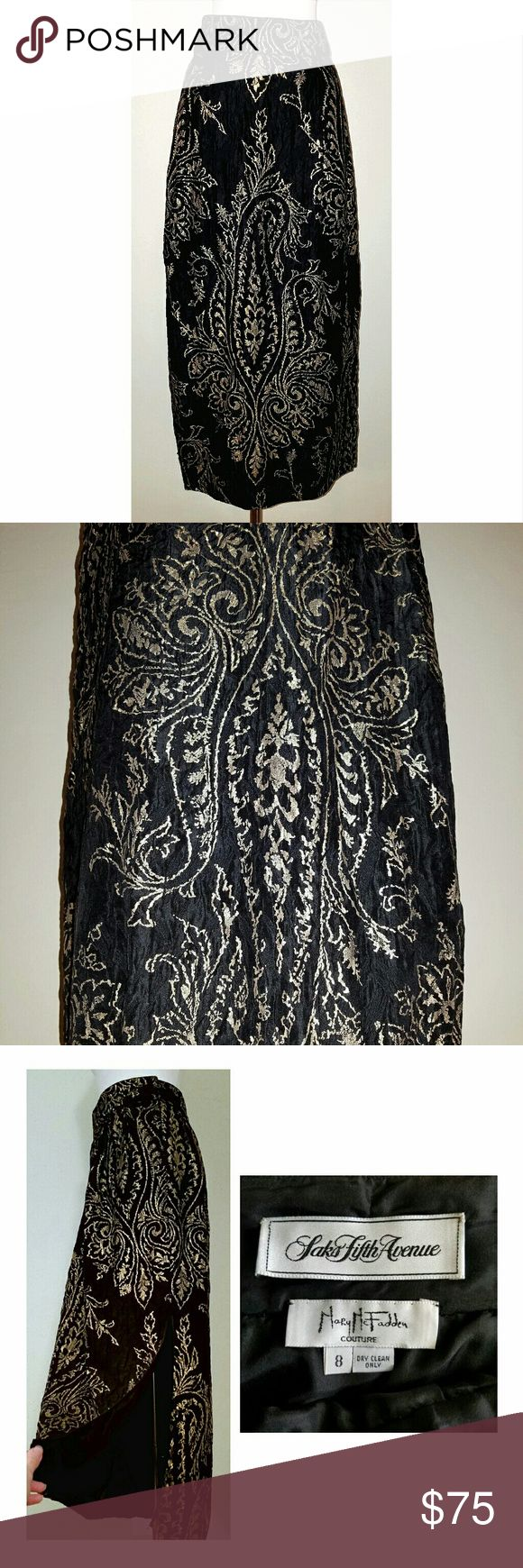 "Vtg MaryMcFadden Couture HighWaist BlackGold Skirt Saks Fifth Avenue vintage. Gorgeous gold paisley design on black. High side slit. High waisted. Fabric has puckered dimpled look (see photo), lightweight w/ slight sheen. Full silky lining. Side zipper and double hook closure. Length- 35.75"" (bottom hem)- 20"" (top of side slit), Waist- 28"" (higher than natural waist), Hips- 44"". Dry clean only. No fabric tag. GREAT condition for vintage item (no tears, no stains, gold paisley rubbing off in…"
