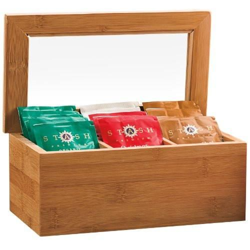 """An earth-friendly way to organize your favorite Stash Teas. Holds up to 60 tea bags. Details MaterialBamboo CapacityHolds up to 60 tea bags Dimensions9"""" L x 5"""""""