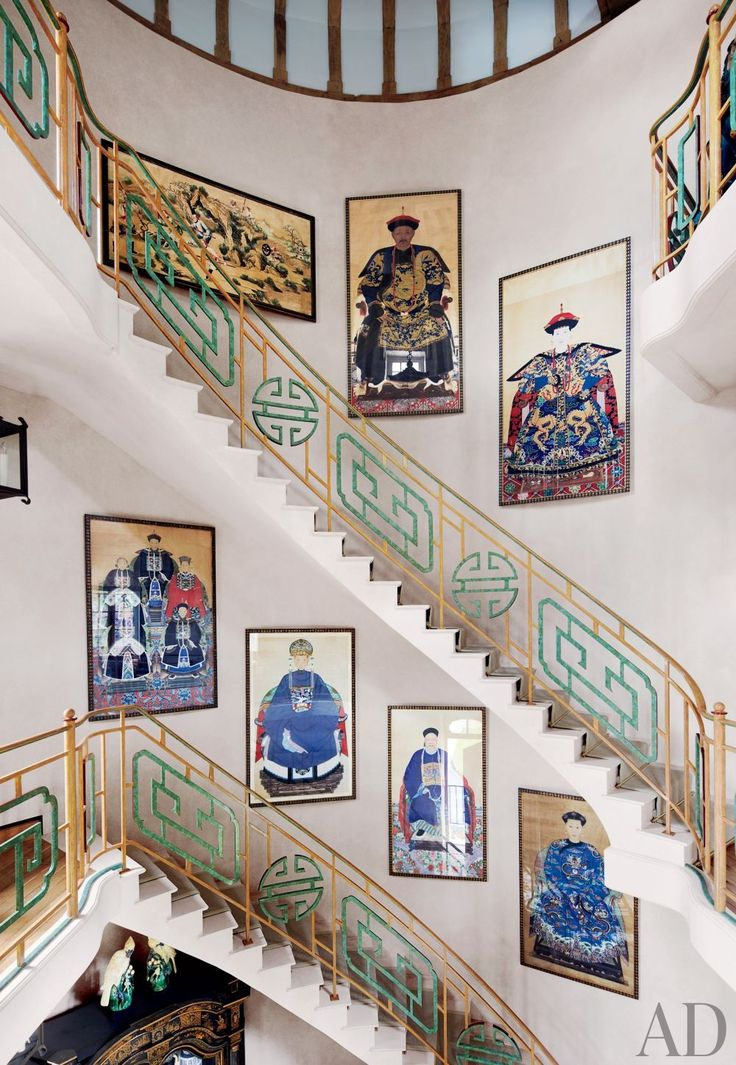 Chinese ancestor portraits from the early 19th century line the curving staircase in the pigeonnier at Valentino Garavani's French estate.