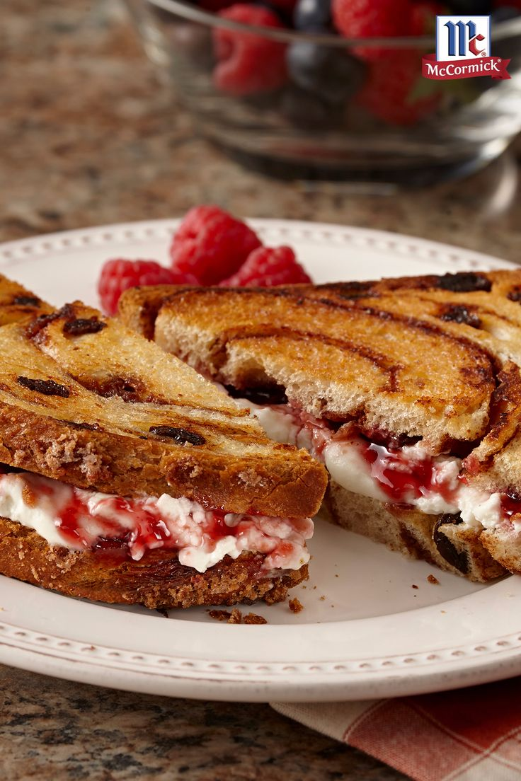 If you prefer a sweet grilled cheese sandwich instead of a savory one, try this version. Cream cheese and vanilla-accented raspberry jam are spread on cinnamon raisin bread before toasting for quick and delicious breakfast dish.