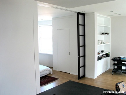 Use Bookcase Wall To Support Accentuate Pocket Door