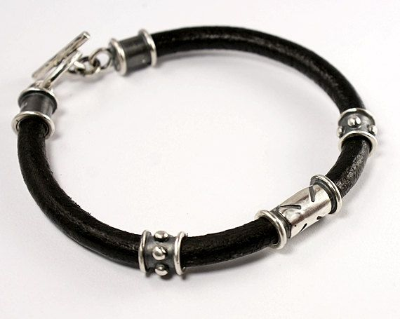 CRUSADER - HANDMADE BRACELET The bracelet is made of natural leather and 100% sterling silver . Made of silver 925 and 930, oxidized and puree in vintage