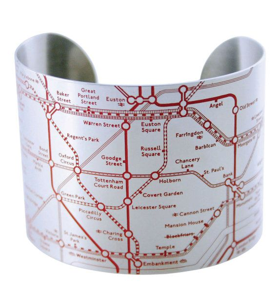 Looking for a stylish alternative to that foldout map you happened upon while entering the Piccadilly Circus Tube station? Look no further, hop easily and fashionably from the Tate Modern to Hyde Park with the London Tube Cuff, which details the lines, streets and major stops of Londons Underground. Officially Licensed by TfL.  Size: 2 D + 2 W  Color Options: Shiny Red, Shiny (no color), Black matte, Matte (no color)