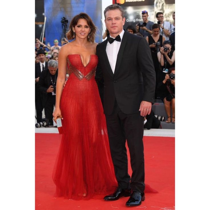 #MattDamon in a classic black, shawl collar #Versace tuxedo and Luciana Damon in a red strapless #AtelierVersace gown for the Opening Ceremony of the 74th Annual #VeniceFilmFestival. #VersaceCelebrities