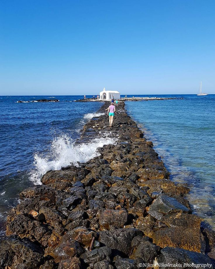 Crossing the rocky islet to the Chapel of Agios Nikolaos in Georgioupolis. It's a small seaside town  38 km southeast of Chania in West Crete. The white chapel is built on a rock in the middle of the sea and is dedicated to Saint Nicholas the protector of seafarers. Happy Sunday!