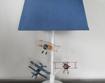 Ready to Ship Flying Airplanes Lamp & Shade! Three metal Airplane in flight create a magical look for this white lamp with Navy Blue Shade!
