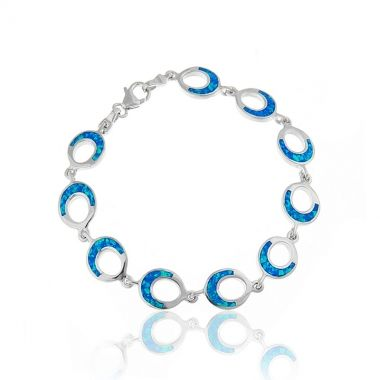 Sterling silver bracelet featuring ten circles linked together in 925 silver with blue opal inlay. Similar to the colour of the Cyclades sea, the vibrant blue opal and the sterling silver with polished finish, create a captivating sterling silver bracelet that is full of elegance. Wear it alone and carry with you the colours of the greek sea wherever you go. Add a pop of colour to any ensemble by matching this sterling silver bracelet with blue opal sterling silver stud earrings.