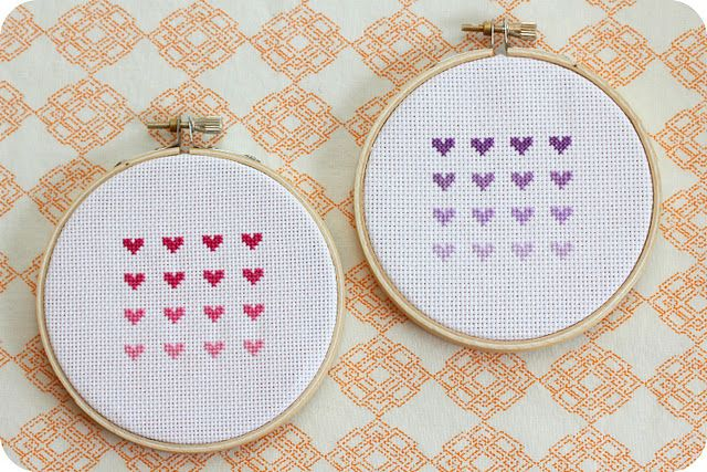 cross stitch ombre hearts - Project estimate: Fabric, on hand or $1 and up Embroidery hoop, $1 and up Embroidery floss, on hand or $1 and up Note: Instead of buying four colors of thread, you can start with white and use RIT dye or Kool-Aid to color it. For each shade, leave the thread in longer to create a darker color.