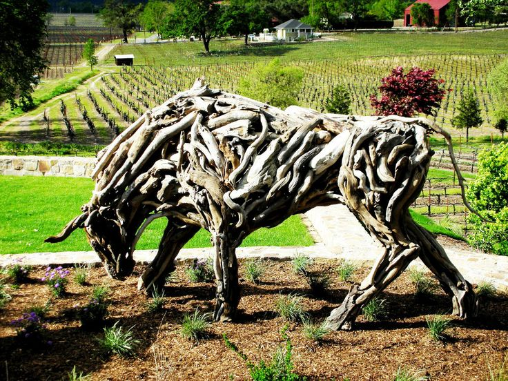 Driftwood Bull sculpture, life size commissioned for Trinchero family estate winery in St. Helena, CA. Matt Torrens Driftwood Sculpture Artist