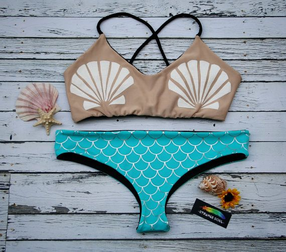 """Seamless Brazilian style cheekster bottoms that are fully reversible. They feature an aqua and metallic silver mermaid scale pattern on one side and completely reverse to neutral black on the other side. Cheeky bottoms are perfect for tanning with very minimal tan lines. Cheeky bottoms can be worn 4 ways - the front and backs are interchangeable for a more revealing or moderate cut. *** Please give our shop refund & exchange policy a read prior to purchase by clicking on """"Shop Policies."""" ..."""