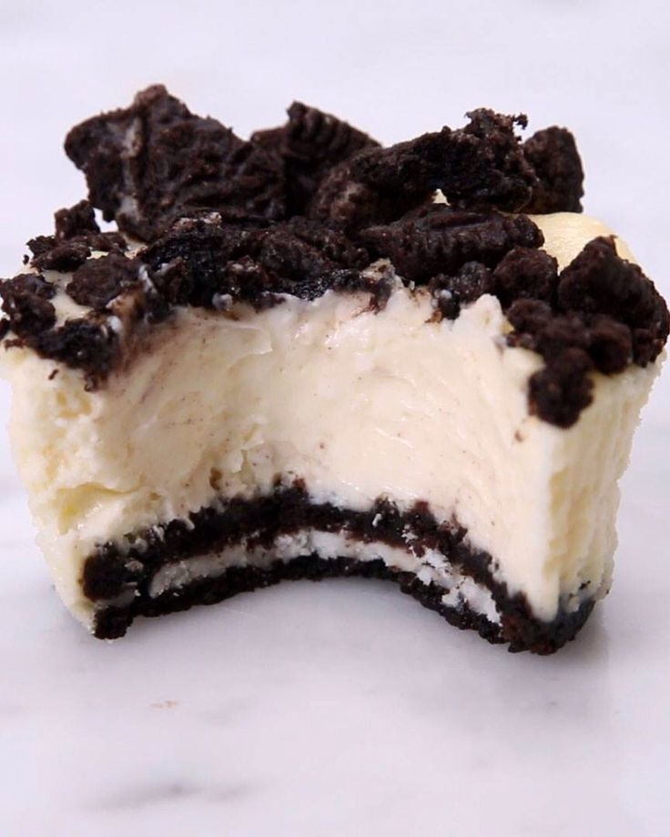 Mini Oreo cheese cakes  16 oz cream cheese, softened 1/2 cup sour cream 1/2 cup sugar 1 Tbsp. vanilla 2 eggs 12 Oreo cookies crushed Oreos for topping Muffin tin liners  Mix the cream cheese, sour cream, sugar, vanilla, and eggs until well combined.  Line a muffin tin with paper liners (white looks the cutest), and place a whole Oreo at the bottom of each liner.  Top with cheesecake mixture and crumbled Oreos (you can mix them into the cheesecake if you prefer).  Bake at 275°F/135°C for 22…