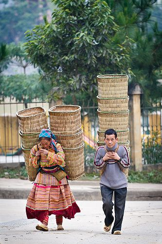 Off to sell their baskets at the market of Bac Ha village, Vietnam