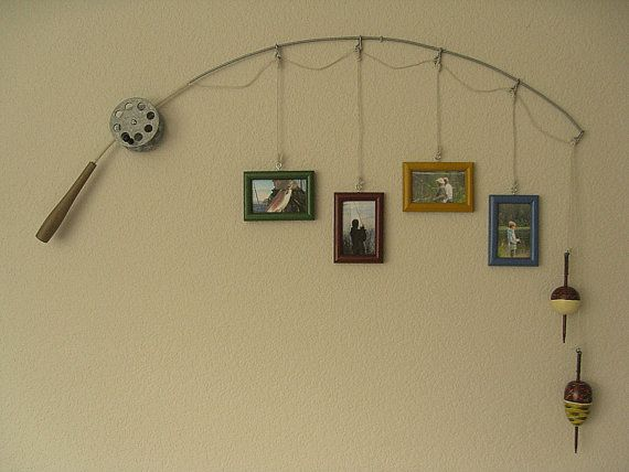 Picture frames hanging from a fishing pole. @Sandra Pendle Pendle Pendle Pendle Stone bryant